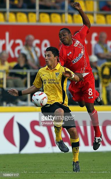 Tolgay Arslan of Aachen and Macchambes Mouhani of Union Berlin go up for a header during the Second Bundesliga match between Alemannia Aachen and FC...