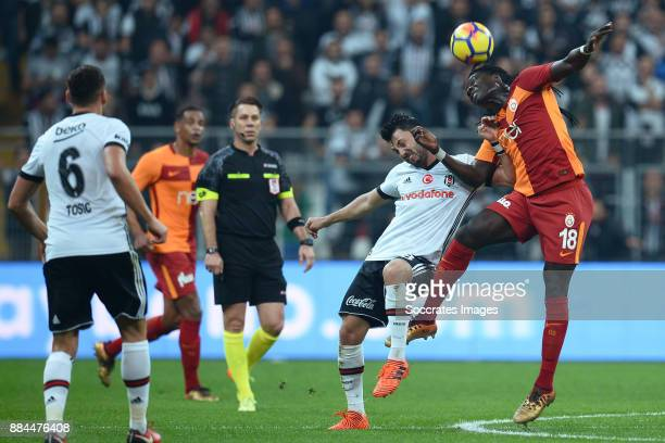 Tolgay Arslan of Besiktas Bafetimbi Gomis of Galatasaray during the Turkish Super lig match between Besiktas v Galatasaray at the Vodafone Park on...