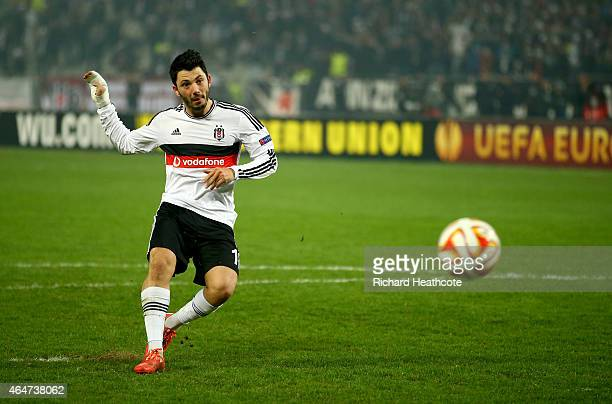 Tolgay Arslan of Besiktas scores his penalty in the shoot out during the 2nd leg of the UEFA Europa League Round of 32 match between Besiktas and...
