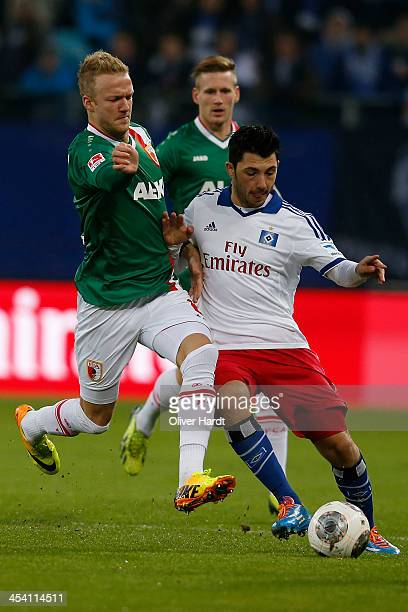 Tolgay Arslan of Hamburg and Kevin Vogt of Augsburg compete for the ball during the Bundesliga match between Hamburger SV and FC Augsburg at Imtech...
