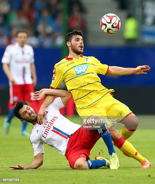 Tolgay Arslan of Hamburg and Kevin Volland of Hoffenheim battle for the ball during the Bundesliga match between Hamburger SV and 1899 Hoffenheim at...