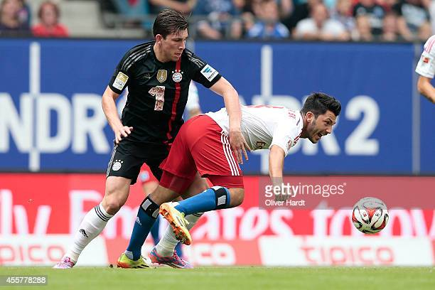 Tolgay Arslan of Hamburg and Pierre Emile Hojbjerg of Munich compete for the ball during the Bundesliga match between Hamburger SV and FC Bayern...