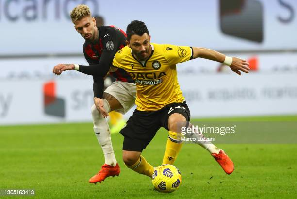 Tolgay Arslan of Udinese Calcio battles for possession with Samu Castillejo of A.C. Milan during the Serie A match between AC Milan and Udinese...