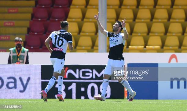 Tolgay Arslan of Udinese Calcio celebrates with Nahuel Molina after scoring their side's second goal during the Serie A match between Benevento...