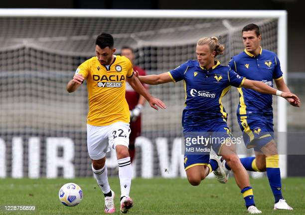 Tolgay Arslan of Udinese Calcio competes for the ball with Antonin Barak of Hellas Verona FC ,during the Serie A match between Hellas Verona FC and...