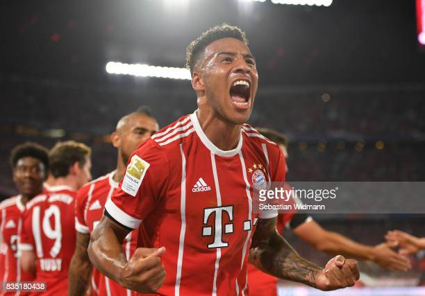 Tolisso of Bayern Muenchen celebrates his goal with his team mates during the Bundesliga match between FC Bayern Muenchen and Bayer 04 Leverkusen at...