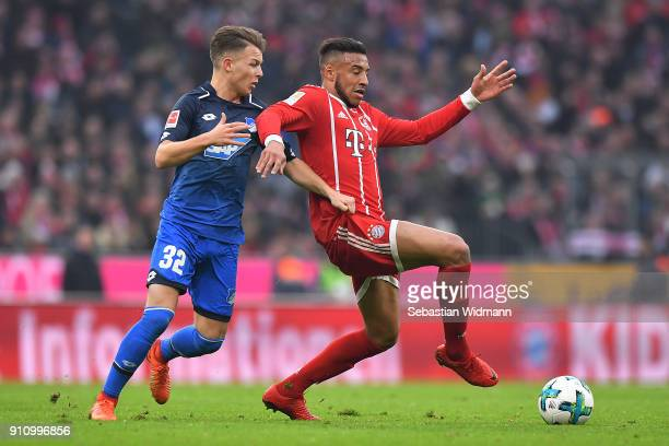 Tolisso of Bayern Muenchen fights for the ball with Dennis Geiger of Hoffenheim during the Bundesliga match between FC Bayern Muenchen and TSG 1899...