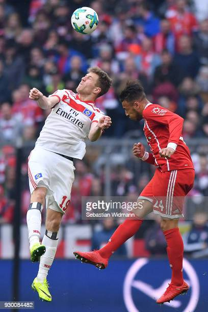 Tolisso of Bayern Muenchen fights for the ball with Sven Schipplock of Hamburg during the Bundesliga match between FC Bayern Muenchen and Hamburger...