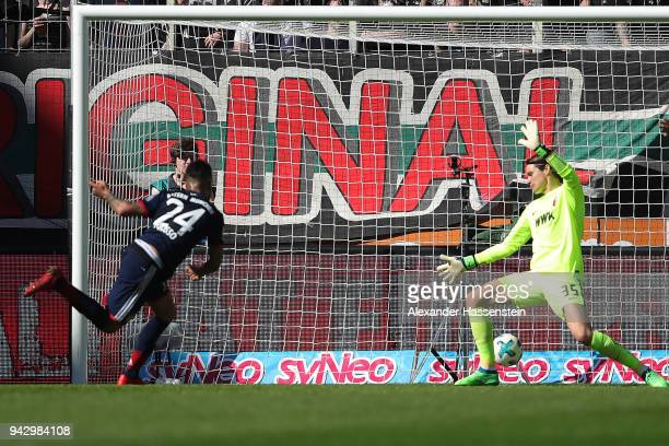 Tolisso of Bayern Muenchen scores a goal to make it 11 past goalkeeper Marwin Hitz of Augsburg during the Bundesliga match between FC Augsburg and FC...