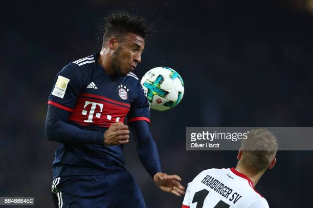 Tolisso of Bayern Muenchen with Aaron Hunt of Hamburg during the Bundesliga match between Hamburger SV and FC Bayern Muenchen at Volksparkstadion on...