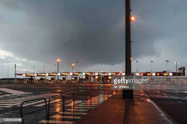 toll booth in calais on rainy evening - doncaster stock pictures, royalty-free photos & images