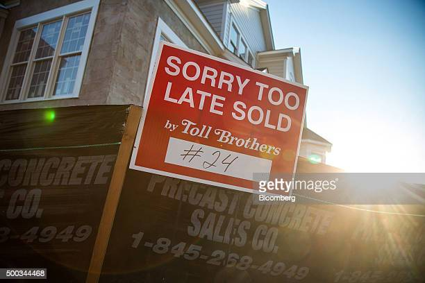 Toll Brothers Inc signage is displayed in front of a home under construction at the company's Enclave at Rye Brook housing development in Rye Brook...