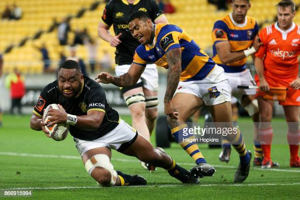 Tolu Fahamokioa of Wellington scores a try under pressure from Monty Ioane of Bay of Plenty during the Mitre 10 Cup Championship Final match between...