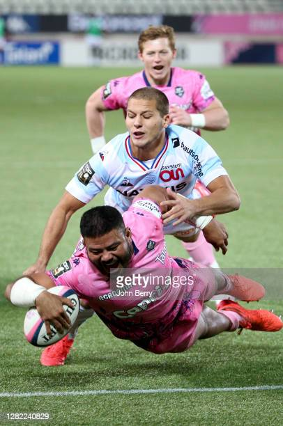 Tolu Latu of Stade Francais scores a try, Antoine Gibert of Racing 92, John Hall of Stade Francais during the Top 14 rugby match between Stade...