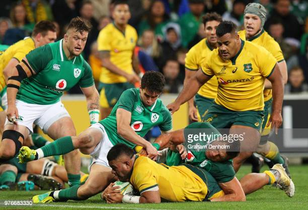 Tolu Latu of the Wallabies gets stopped just short of the try line by the Ireland defence during the International test match between the Australian...