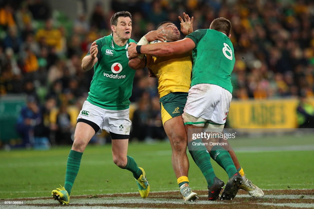 Tolu Latu of the Wallabies (C) is tackled during the International test match between the Australian Wallabies and Ireland at AAMI Park on June 16, 2018 in Melbourne, Australia.