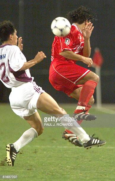 D Toluca FC midfielder Fabian Estay is about to be tripped for a foul by Deportivo Saprissa defenseman Vladimir Quesada during first half 1998...