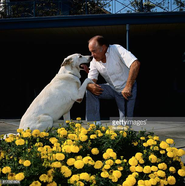 """Toluca Lake, California: Nose-to-nose in front of the marigolds are Bob Hope and his Alsation """"My Dog"""" as they prepare for what looks like a new dog..."""