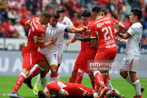 TOPSHOT Toluca's and Guadalajara's players fight during their Mexican Apertura 2018 tournament football match at the Nemesio Diez stadium in Toluca...