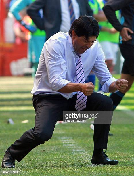 Toluca's coach Jose Cardozo celebrates defeating Cruz Azul during their Mexican Clausura tournament football match at the Nemesio Diez stadium on...