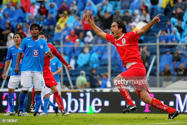 Toluca's Edgar Duenas celebrates his scored goal during their match against Cruz Azul in the 2009 Opening tournament the closing stage of the Mexican...