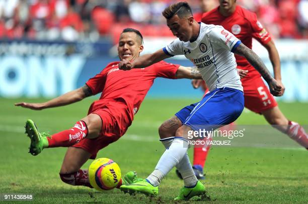 Toluca's Rodrigo Salinas vies for the ball with Cruz Azul's Martin Rodriguez during the 2018 Mexican Clausura tournament football match at the...