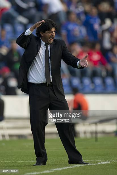 Toluca's team coach Jose Saturnino Cardozo gestures during the Apertura 2013 Mexican tournament football match against Cruz Azul at the Cruz Azul...