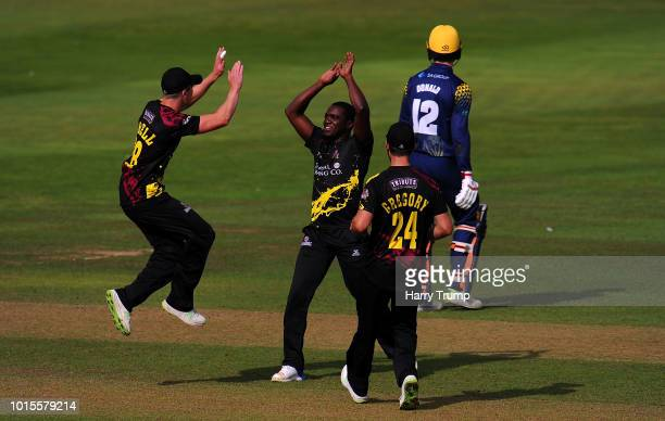 Tom Abell and Jerome Taylor of Somerset celebrate the wicket of Anuerin Donald of Glamorgan during the Vitality Blast match between Somerset and...