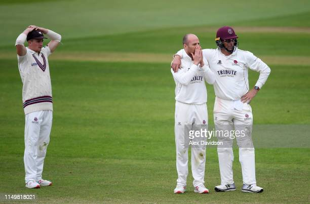 Tom Abell Jack Leach and Marcus Trescothick of Somerset reacts to a chance during Day Four of the Specsavers County Championship match between...