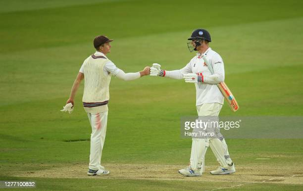 Tom Abell of Somerset and Simon Harmer of Essex embrace at the end of the match during Day Five of the Bob Willis Trophy Final match between Somerset...
