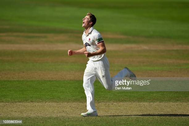Tom Abell of Somerset celebrates taking the wicket of Dean Elgar of Surrey during day two of the Specsavers County Championship Division One match...