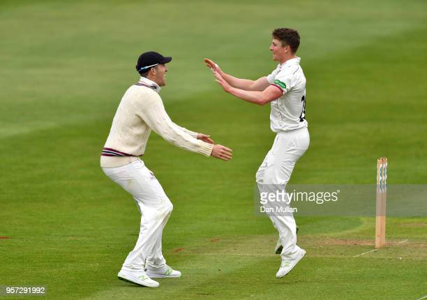Tom Abell of Somerset celebrates with Craig Overton of Somerset after taking the wicket of James Vince of Hampshire during day one of the Specsavers...