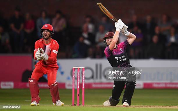 Tom Abell of Somerset plays a shot as Dane Vilas of Lancashire Lightning looks on during the Vitality T20 Blast Quarter Final match between Somerset...