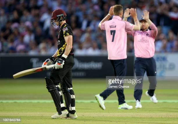 Tom Abell of Somerset walks off dejected after being bowled by Tom Helm of Middlesex who celebrates his wicket during the Vitality Blast match...