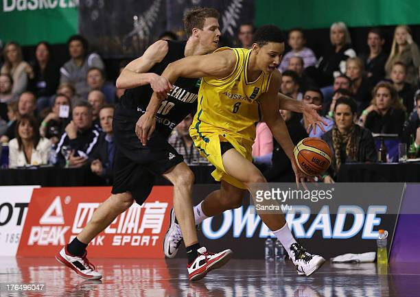 Tom Abercrombie of New Zealand and Ben Simmons of Australia in action during the Men's FIBA Oceania Championship match between the New Zealand Tall...