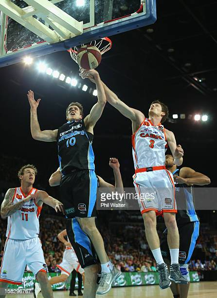 Tom Abercrombie of the Breakers and Cam Gliddon of the Taipans compete for the ball during the round 11 NBL match between the New Zealand Breakers...