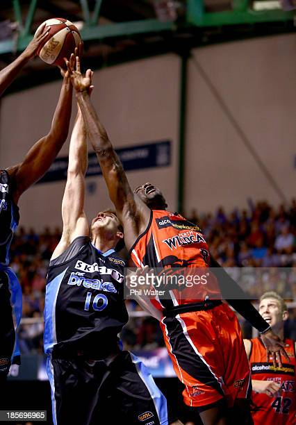 Tom Abercrombie of the Breakers and James Ennis of the Wildcats compete for the ball during the round three NBL match between the New Zealand...