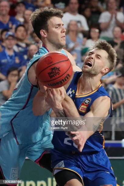 Tom Abercrombie of the Breakers and Nathan Sobey of the Bullets collide during the round 11 NBL match between the Brisbane Bullets and the New...