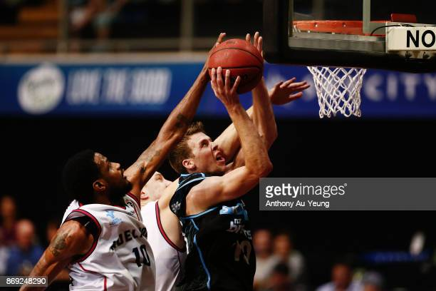 Tom Abercrombie of the Breakers goes up against Ramone Moore of the 36ers during the round five NBL match between the New Zealand Breakers and the...