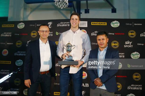 Tom Abercrombie of the Breakers is presented with the Most Valuable Player Award from Head Coach Dan Shamir and Tex Teixeira of Sky Sports during the...