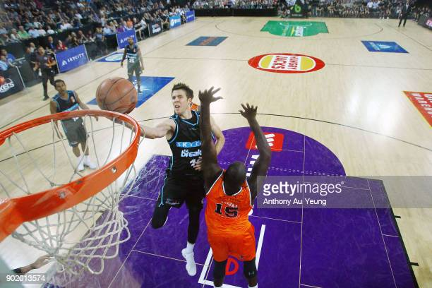 Tom Abercrombie of the Breakers scores against Nathan Jawai of the Taipans during the round 13 NBL match between the New Zealand Breakers and the...