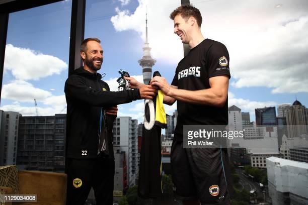 Tom Abercrombie of the NZ Breakers and Andrew Durante of the Wellington Phoenix exchange jerseys during the NZ Breakers and Phoenix Media opportunity...