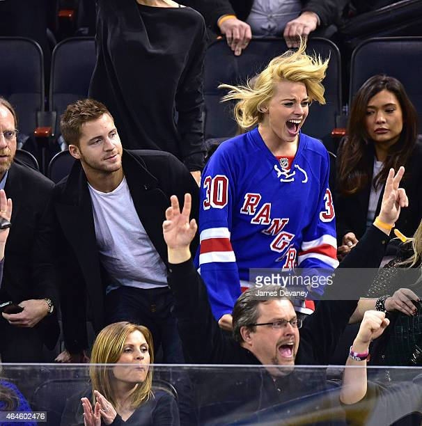 Tom Ackerley and Margot Robbie attend the Arizona Coyotes vs New York Rangers game at Madison Square Garden on February 26 2015 in New York City