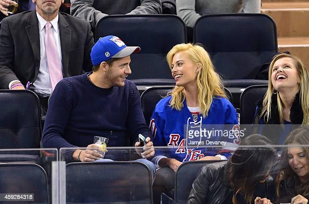 Tom Ackerley and Margot Robbie attend the Philadelphia Flyers vs New York Rangers game at Madison Square Garden on November 19 2014 in New York City