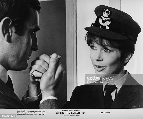 Tom Adams kisses Dawn Addams hands in a scene from the movie Where the Bullets Fly circa 1966