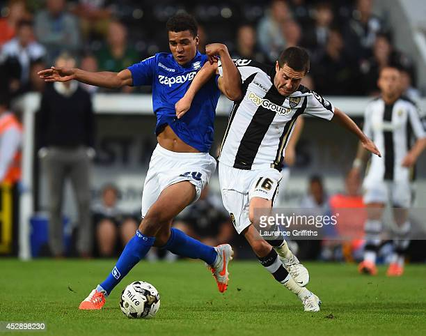 Tom Adeyemi of Birmingham City battles with Liam Noble of Notts County during the Pre Season Friendly match between Notts County and Birmingham City...