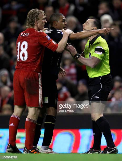 Tom Adeyemi of Oldham Athletic is restrained after being abused by fans on the Kop during the FA Cup 3rd Round match between Liverpool and Oldham...