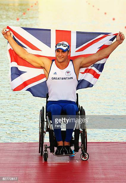 Tom Aggar of Great Britain celebrates after winning the gold medal in the Rowing Men's Single Sculls Final at Shunyi Olympic RowingCanoeing Park...