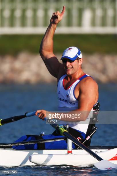 Tom Aggar of Great Britain celebrates after winning the Rowing Men's Single Sculls Final at Shunyi Olympic RowingCanoeing Park during day five of the...