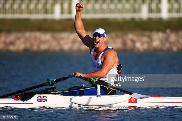 Tom Aggar of Great Britain celebrates after winning the Rowing Men's Single Sculls Final at Shunyi Olympic Rowing-Canoeing Park during day five of...